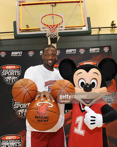 In this handout image provided by Walt Disney Studios, Miami Heat guard Dwyane Wade poses July 11, 2010 with a basketball-clad Mickey Mouse at the...