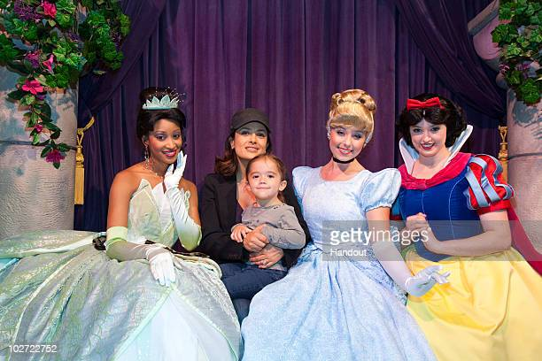 In this handout image provided by Walt Disney Studios Salma Hayek and daughter Valentina meet Disney Princesses Tiana Cinderella and Snow White at...