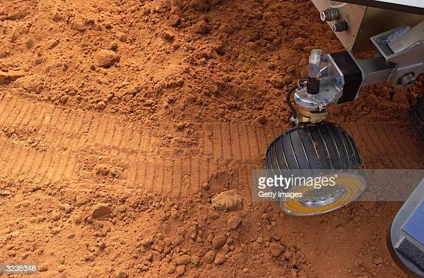 In this handout image provided by Walt Disney World Resort a simulated Mars Rover makes tracks through red soil at Walt Disney World Resort April 6...