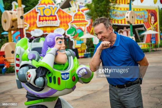 In this handout image provided by Walt Disney World Resort actor Tim Allen and Buzz Lightyear calls Star Command during a special preview of Toy...