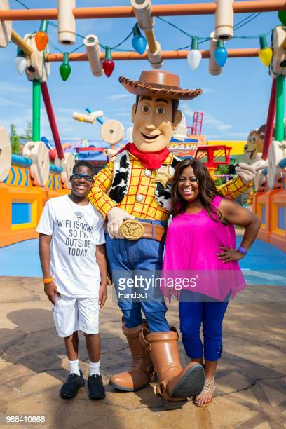In this handout image provided by Walt Disney World Resort actress Sherri Shepherd and son Jeffrey share a special moment with Woody while previewing...