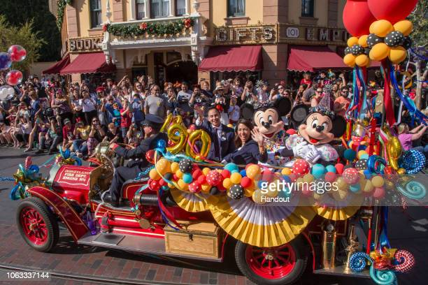 In this handout image provided by Walt Disney World Resort Disneyland guests and Cast Members celebrate Mickey Mouses 90th birthday November 18...