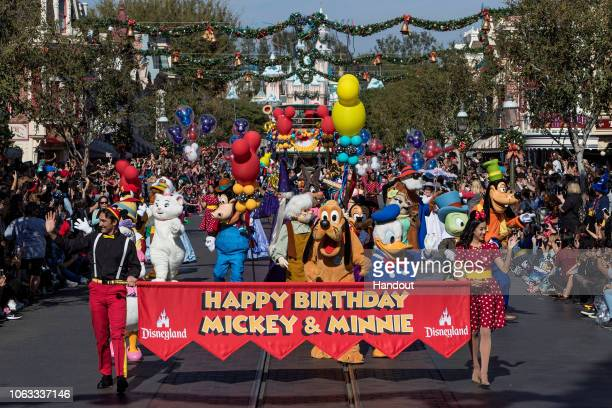 In this handout image provided by Walt Disney World Resort Disneyland guests and Cast Members join a flurry of Disney characters to celebrate Mickey...