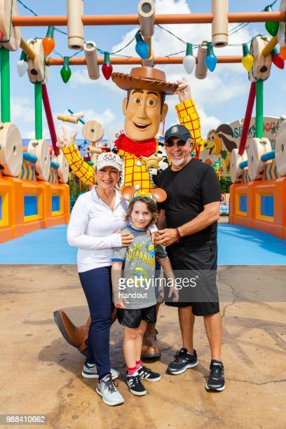 In this handout image provided by Walt Disney World Resort Gloria Estefan Emilio Estefan and their grandson Sasha pose with Woody while previewing...