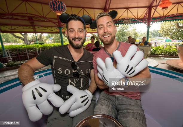 In this handout image provided by Walt Disney World Resort Lance Bass and husband Michael Turchin take a teacup for a colorful spin at the Mad Tea...