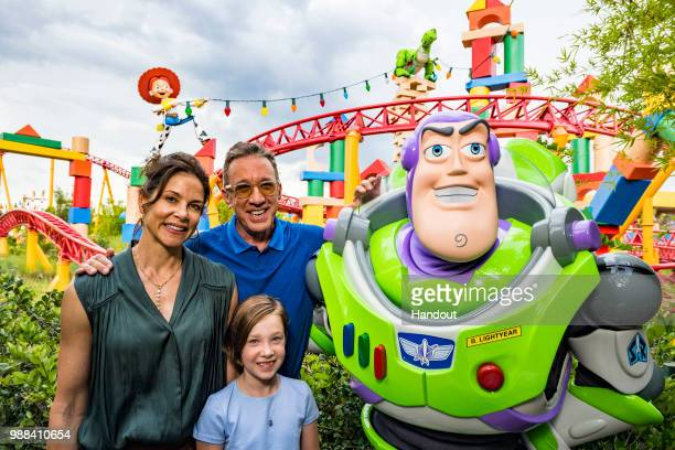 In this handout image provided by Walt Disney World Resortactor Tim Allen his wife Jane and daughter Elizabeth pose with Buzz Lightyear during a...