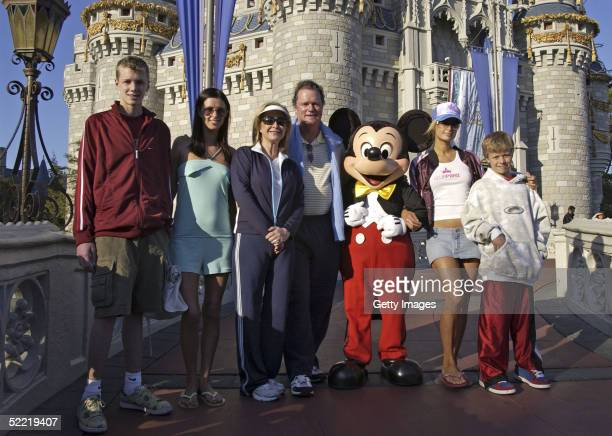 In this handout image provided by Walt Disney World the Hilton family Conrad Nicky parents Kathy and Rick Paris and Barron pose with Mickey Mouse at...