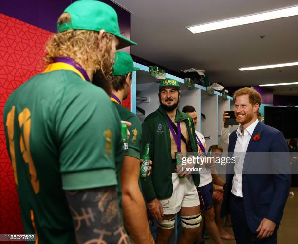In this handout image provided by World Rugby Prince Harry Duke of Sussex speaks to players of South Africa following their victory against England...