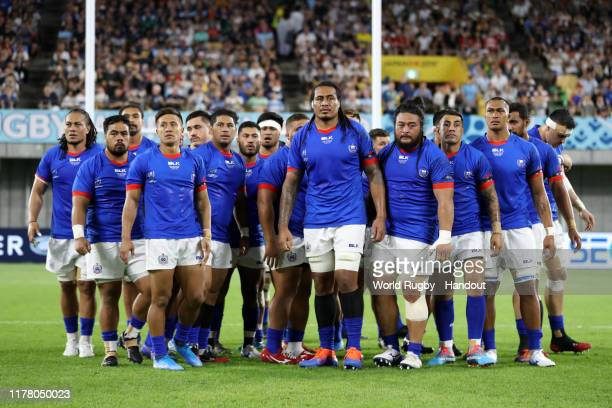 In this handout image provided by World Rugby The Samoa players perform the Siva Tau prior to the Rugby World Cup 2019 Group A game between Scotland...