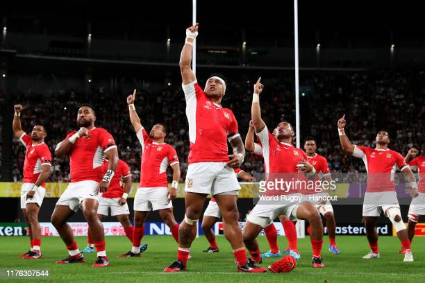 In this handout image provided by World Rugby, Tonga players perform the Sipi Tau prior to the Rugby World Cup 2019 Group C game between England and...