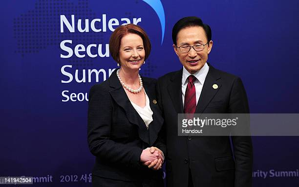 In this handout image provided by Yonhap News Australian Prime Minister Julia Gillard and South Korean President Lee Myungbak pose for photogrpahs...