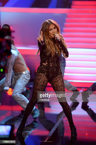In this handout image provided by ZDF Jennifer Lopez performs on stage during the 200th 'Wetten dass' show at the ISS Dome on October 6 2012 in...