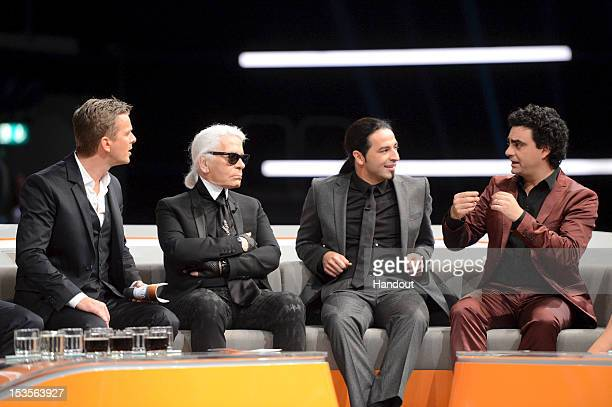 In this handout image provided by ZDF Markus Lanz Karl Lagerfeld Buelent Ceylan and Rolando Villazon talk on stage during the 200th 'Wetten dass'...