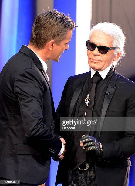 In this handout image provided by ZDF Markus Lanz welcomes Karl Lagerfeld during his first 'Wetten dass' show at the ISS Dome on October 6 2012 in...