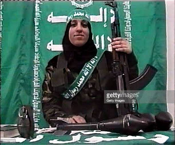 In this handout image Reem Slaleh Raiyshi a mother of two children from Gaza makes a statement while holding weapons in this image taken from a Hamas...