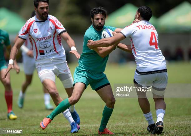 In this handout image released by APO Group Achabar Adil of Morocco is tackled by Ailuif Dhif of Tunisia during the Rugby Africa The Africa Men's...