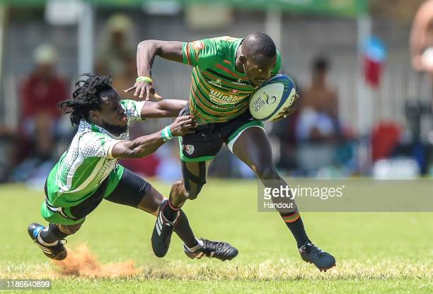 In this handout image released by APO Group Assez Olaitan Ladipo of Nigeria in action against Zambia during the Rugby Africa The Africa Men's Sevens...