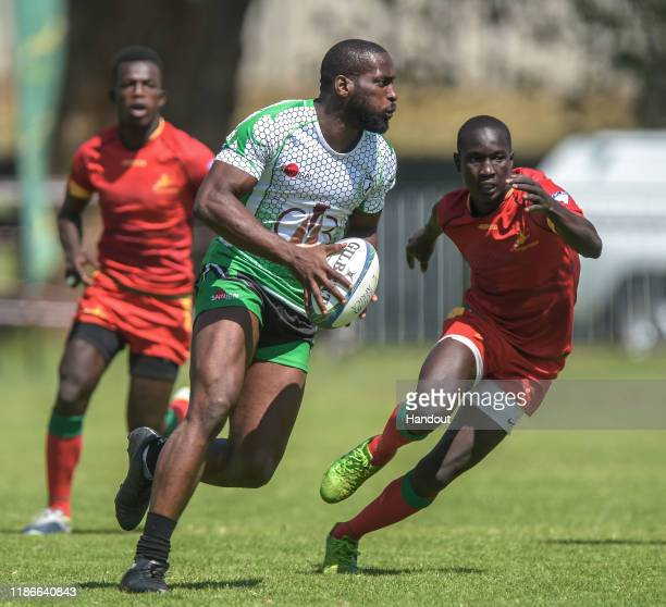 In this handout image released by APO Group Chiemerie Felix of Nigeria is pursued by Diaby Ibrahim of Senegal during the Rugby Africa The Africa...