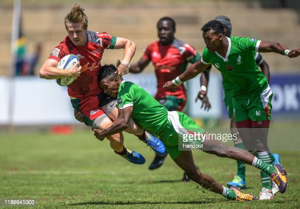 In this handout image released by APO Group Oscar Dennis of Kenya is tackled by a Madagascar player during the Rugby Africa The Africa Men's Sevens...
