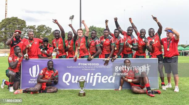 In this handout image released by APO Group Team Kenya receives gold medals and the trophy during the Rugby Africa The Africa Men's Sevens tournament...