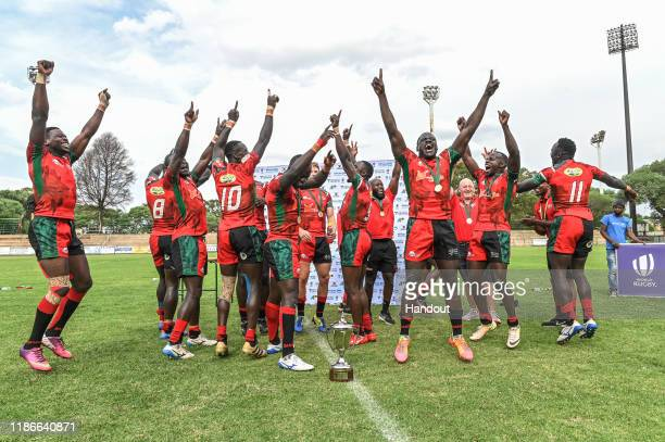 In this handout image released by APO Group Team Kenya receives their gold medals and the trophy during the Rugby Africa The Africa Men's Sevens...