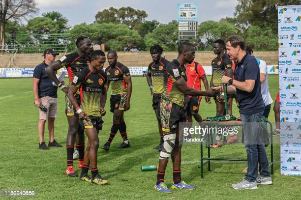 In this handout image released by APO Group Team Uganda collect their silver medals after losing in the final to Kenya during the Rugby Africa The...