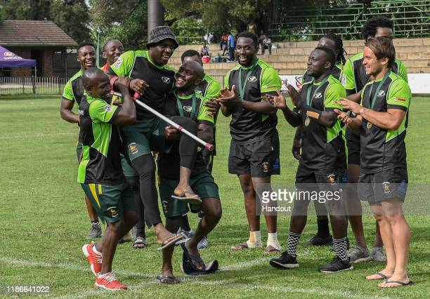In this handout image released by APO Group Team Zimbabwe collect their bronze medals during the Rugby Africa The Africa Men's Sevens tournament at...