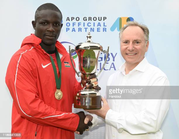 In this handout image released by APO Group The trophy was handed to Kenya's captain Andrew Amonde by Lionel Reina CEO of APO Group during the Rugby...