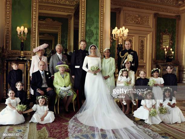 In this handout image released by the Duke and Duchess of Sussex, the Duke and Duchess of Sussex pose for an official wedding photograph with : Back...