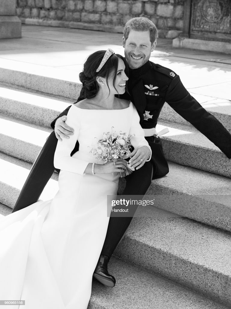 In this handout image released by the Duke and Duchess of Sussex, the Duke and Duchess pictured together in an official wedding photograph on the East Terrace of Windsor Castle on May 19, 2018 in Windsor, England. (Photo by Alexi Lubomirski/The Duke and Duchess of Sussex via Getty Images) NOTE - BLACK AND WHITE ONLY. NEWS EDITORIAL USE ONLY. NO COMMERCIAL USE. NO MERCHANDISING, ADVERTISING, SOUVENIRS, MEMORABILIA or COLOURABLY SIMILAR. NOT FOR USE AFTER 31 DECEMBER, 2018 WITHOUT PRIOR PERMISSION FROM KENSINGTON PALACE. NO CROPPING. Copyright in the photograph is vested in The Duke and Duchess of Sussex. Publications are asked to credit the photographs to Alexi Lubomirski. No charge should be made for the supply, release or publication of the photograph. The photograph must not be digitally enhanced, manipulated or modified in any manner or form and must include all of the individuals in the photograph when published.
