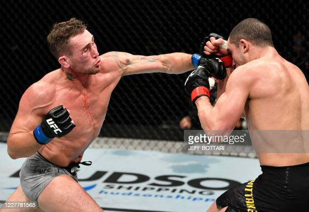 In this handout image released by the Ultimate Fighting Championship , Darren Till of England punches Robert Whittaker of New Zealand, in their...