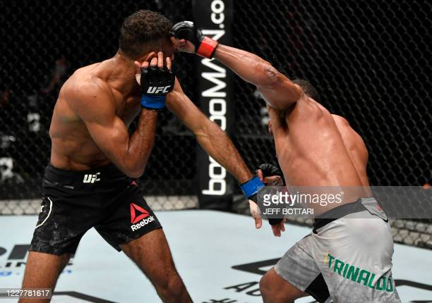 In this handout image released by the Ultimate Fighting Championship Francisco Trinaldo of Brazil punches Jai Herbert of England in their lightweight...