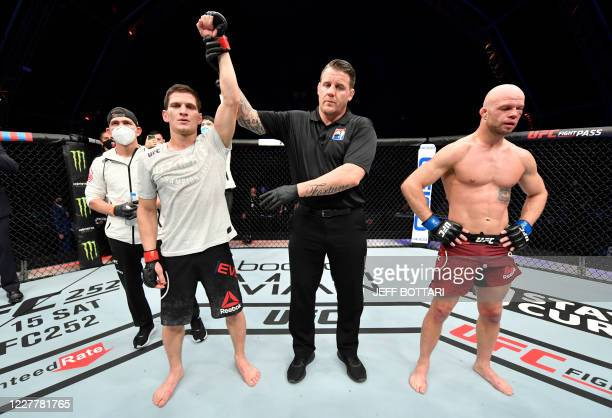 In this handout image released by the Ultimate Fighting Championship Movsar Evloev of Russia celebrates after his victory over Mike Grundy of England...
