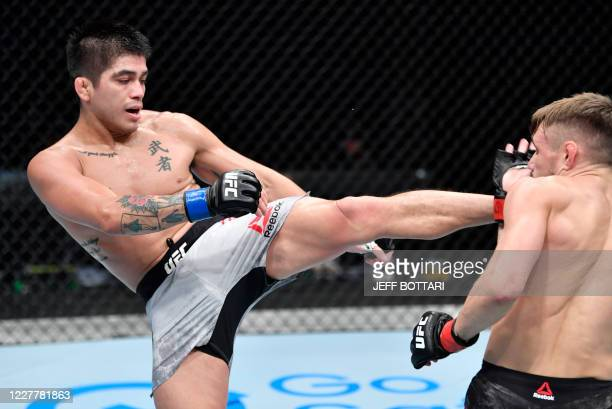 In this handout image released by the Ultimate Fighting Championship , John Castaneda kicks Nathaniel Wood of England in their bantamweight fight...