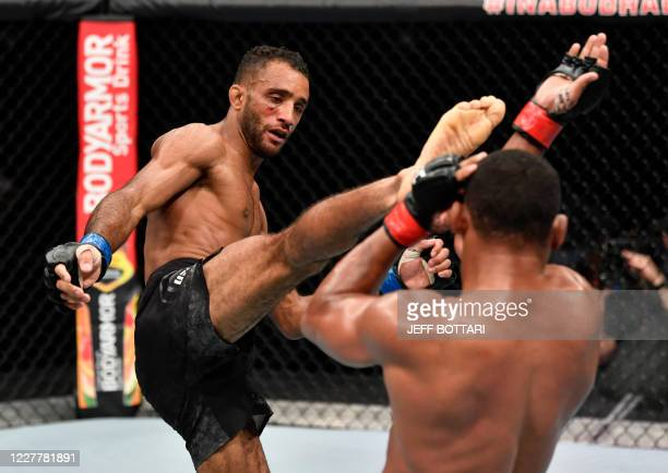 In this handout image released by the Ultimate Fighting Championship , Jai Herbert of England kicks Francisco Trinaldo of Brazil in their lightweight...