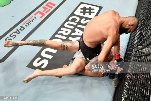 In this handout image released by the Ultimate Fighting Championship Khamzat Chimaev of Czechia punches Rhys McKee of Northern Ireland in their...