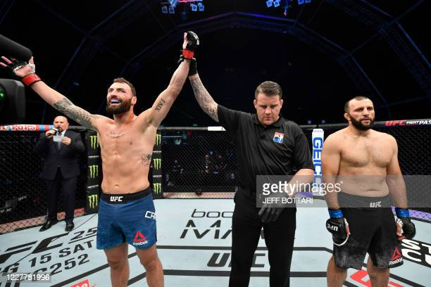 In this handout image released by the Ultimate Fighting Championship , Paul Craig of Scotland celebrates after his victory over Gadzhimurad Antigulov...