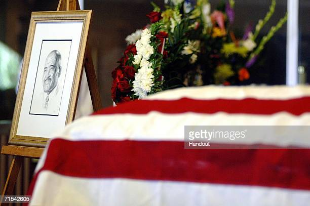 In this handout image released by the US Navy a portrait of Master Chief Boatswain's Mate Carl M Brashear is displayed beside his casket during a...