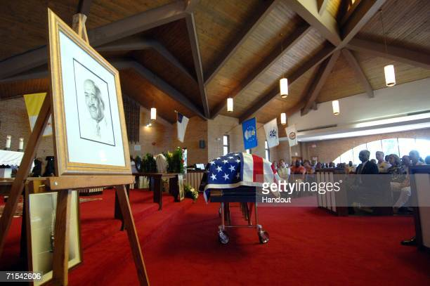In this handout image released by the US Navy family friends and military personnel pay final respects to Master Chief Boatswain's Mate Carl M...