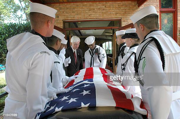 In this handout image released by the US Navy members of the Commander Navy Region MidAtlantic Honor Guard carry the casket of retired Master Chief...