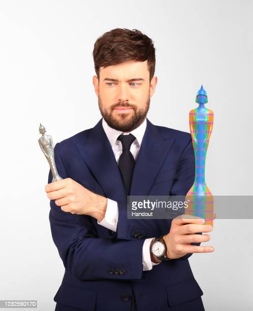 In this handout image released on April 29th, Jack Whitehall poses with this year's BRIT Award on April 29, 2021 in London, England. BRIT Awards host...