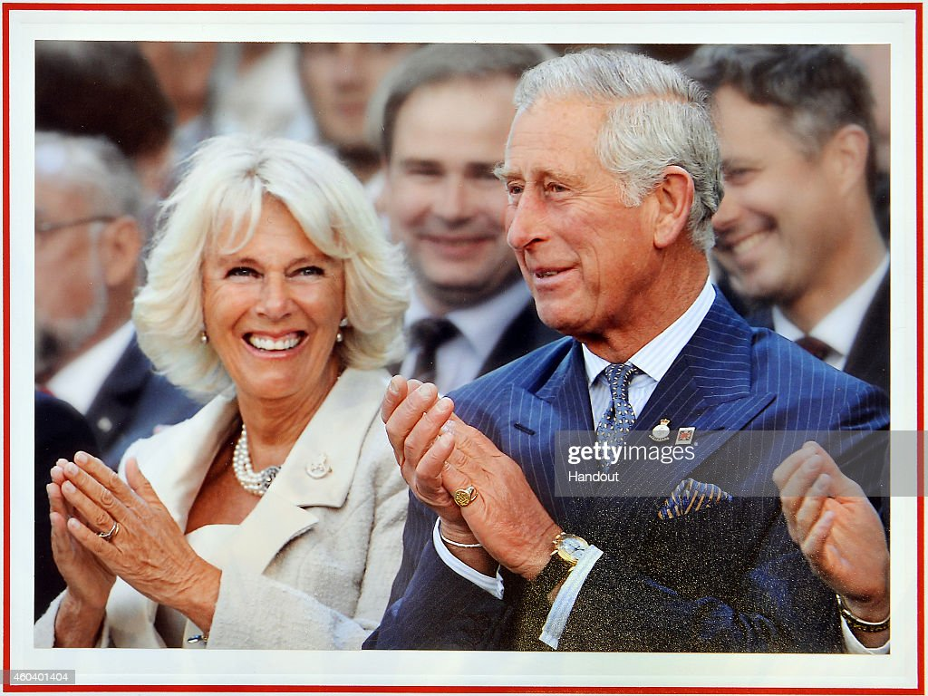 THE PRINCE OF WALES WOULD BE GRATEFUL IF PUBLICATIONS WHO USE THE CARD/PHOTOGRAPH CONSIDER MAKING A DONATION TO 'AID TO THE CHURCH IN NEED.') In this handout image released on December 13, 2014 by Clarence House, shows the personal Christmas card produced for Camilla, Duchess of Cornwall and Prince Charles, Prince of Wales, featuring them in a photograph by Christopher Jackson of Getty Images with the couple laughing during the Invictus Games Opening Ceremony on September 10, 2014 hangs on a Christmas tree on December 11, 2014 in London, England.