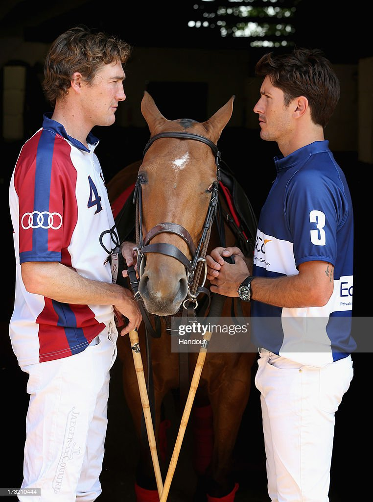 In this handout image supplied by Audi, (L-R) Captain of the UK polo team Luke Tomlinson and Captain of the USA polo team Nic Roldan are seen ahead of the Westchester Cup on July 5, 2013 in Windsor, England.