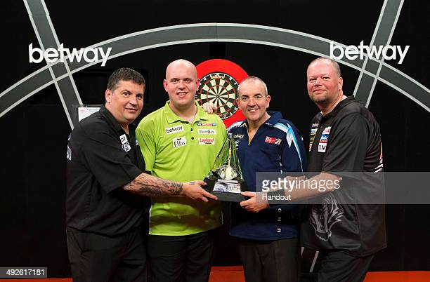 In this handout image supplied by Betway Gary Anderson Michael van Gerwen Phil Taylor and Raymond van Barneveld pose during a photo call ahead of the...