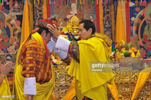 In this handout image supplied by Bhutan Government Department Of Information Technology His Majesty Jigme Singye Wangchuck the Fourth King crowns...