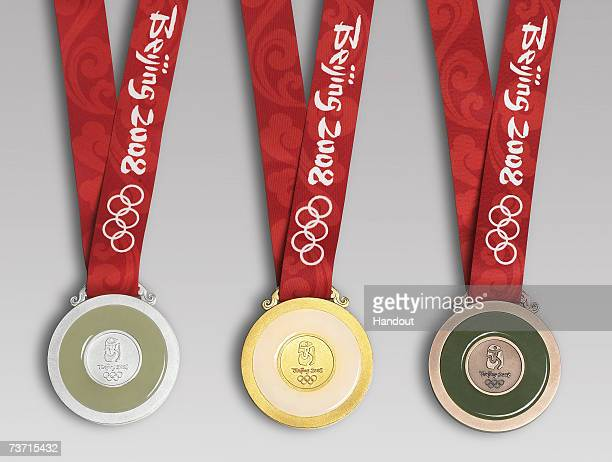 In this handout image supplied by BOCOG, the back of the winning medals for the Beijing 2008 Olympic Games are revealed on March 27, 2007 in Beijing,...