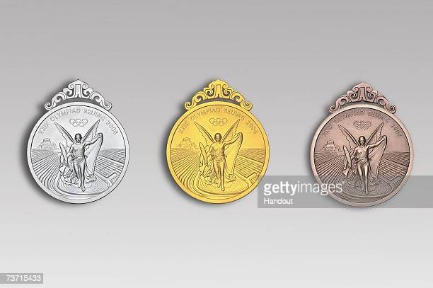 In this handout image supplied by BOCOG the front of the winning medals for the Beijing 2008 Olympic Games are revealed on March 27 2007 in Beijing...