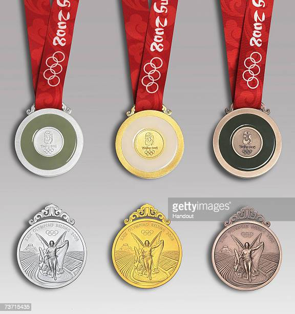 In this handout image supplied by BOCOGThe winning medals for the Beijing 2008 Olympic Games are revealed on March 27 2007 in Beijing China The...