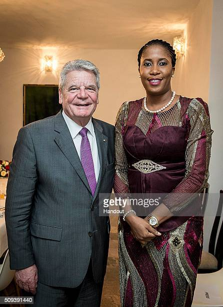 In this handout image supplied by BPA German President Joachim Gauck poses for a photo with Florence Ozor following a meeting with representatives of...