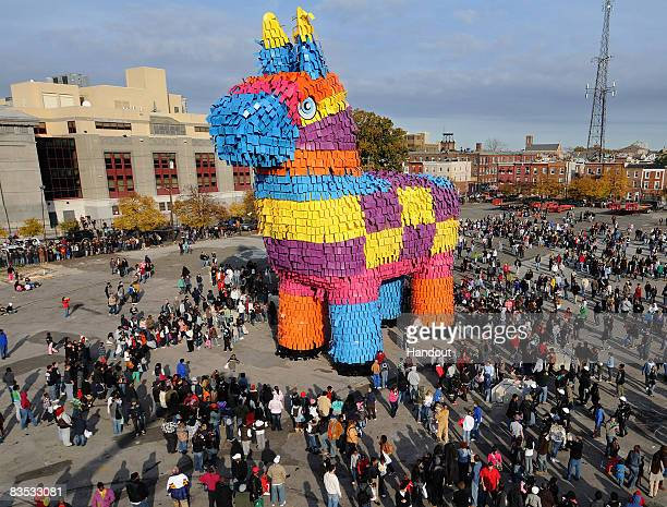 In this handout image supplied by Carnival Cruise Lines film extras surround a huge pinata which has broken the Guinness Record for the world's...